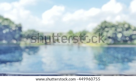 Blur abstract background  resort hotel village swimming pool reflective water surface, Blurryblue cool sky tree around perspective view vacation summer party holiday relaxation pond - stock photo