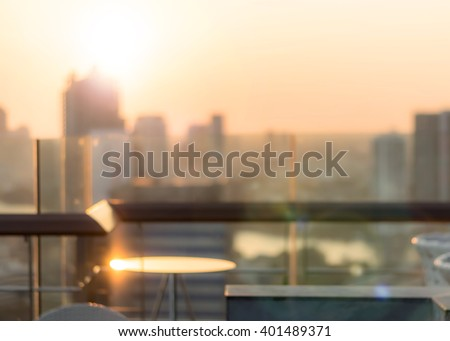 Blur abstract background restaurant dining table with Bangkok cbd city twilight gold evening light rooftop view warm vintage style bokeh flare: Glass table reflection w/ blur backdrop urban cityscape - stock photo