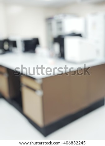 Blur abstract background white microbiology laboratory workstation office with PCR machine and freezer for research or education.Blurry view of empty modern bright science medical or chemical lab room - stock photo