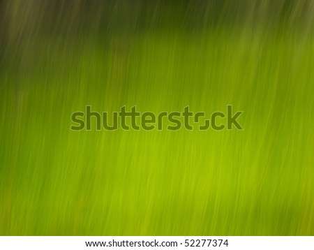 Blur abstract light green lines on dark green background.