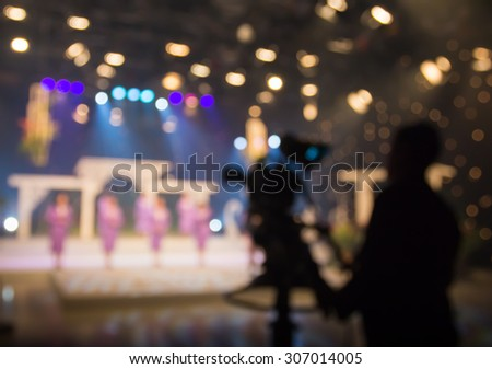 Blur actress or singer in television studio station with camera - stock photo
