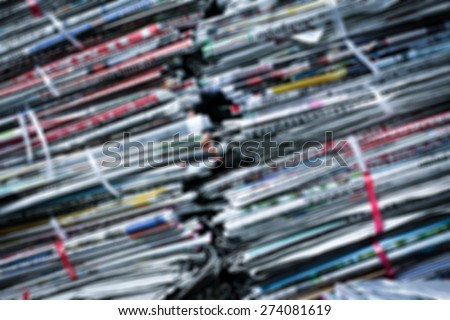 Blur and old newspapers Active and have gathered together to store them. Sort news history. - stock photo