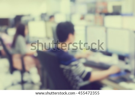 blur asian man operator working searching on computer at office room:blur of trainee monitoring concept:course program:blurry of people,education,business,technology:call center help desk concept - stock photo