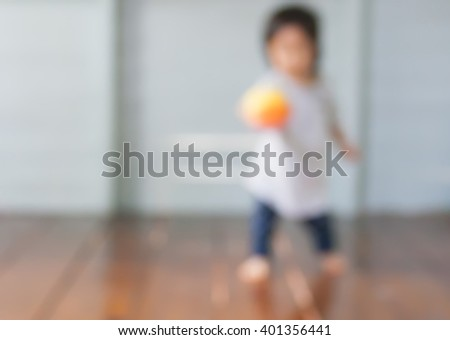 Blur baby is playing her toy - stock photo