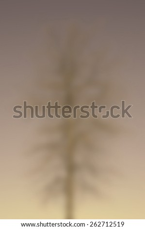 Blur Background Image of a Bare Tree Against a Clear Blue Sky  - stock photo