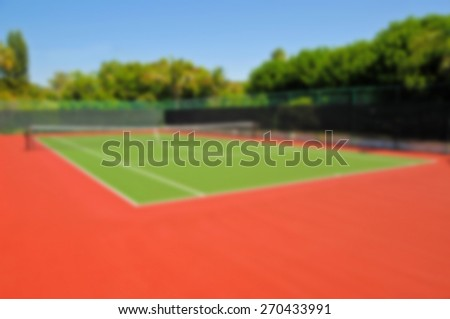 Blur Background Image of a New Tennis Court   - stock photo