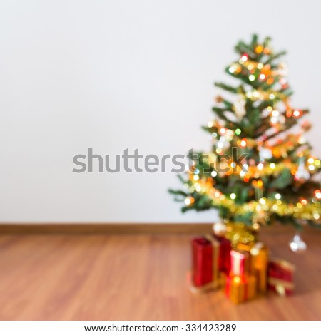 blur background, light celebration on christmas tree with gift box in living room - stock photo
