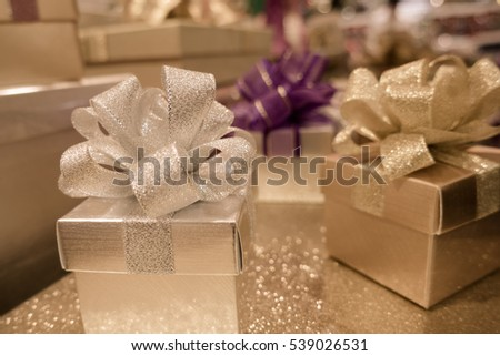 blur background of Gift box and ribbon bow for celebration festival event new year party