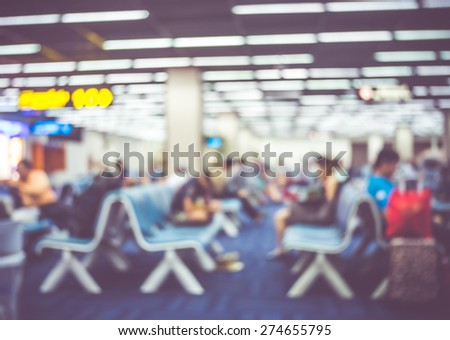 Blur background : passenger airplane at flight sign board with bokeh light - stock photo
