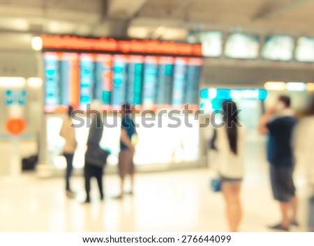 Blur background : passenger airplane at flight sign board with bokeh light. - stock photo