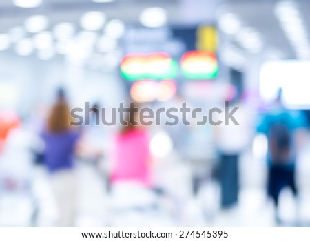 Blur background : passenger airplane waiting for bag at Baggage Claim with bokeh light - stock photo