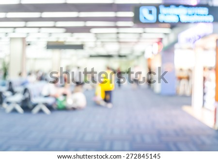 Blur background : Passenger waiting for flight at airport terminal blur background with bokeh light - stock photo