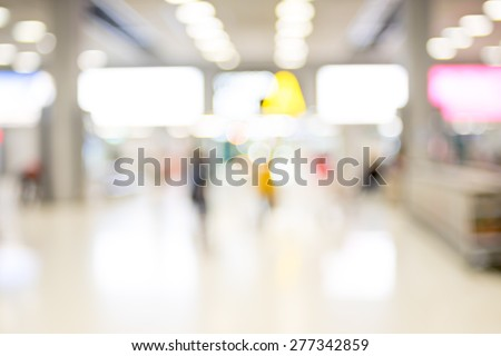 Blur background : Passenger waiting for flight at airport terminal blur background with bokeh light. - stock photo