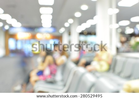 Blur background Passengers wait at airport with bokeh - stock photo