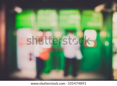 Blur background people withdraw money at  automatic teller machine (ATM) - stock photo