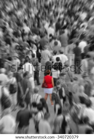 Blur background showing woman in red in a middle of a crowd in black and white - stock photo