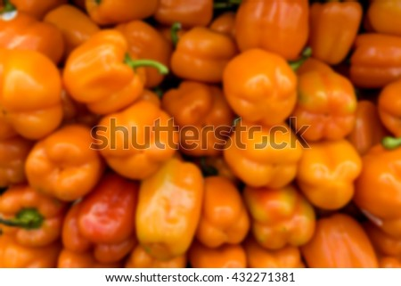 Blur background with fresh paprika, closeup. Image taken at the market - stock photo