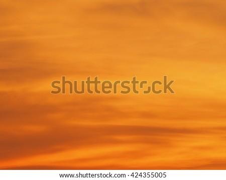 Blur beautiful bright orange sky at sunset sunrise background. Abstract orange sky. Dramatic golden sky at the sunset background. - stock photo
