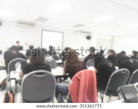 Blur behind student or collegian study, lecture in classroom with notebook and screen projector in bachelor or master or Ph.D. degree in university, college or business seminar, business meeting - stock photo
