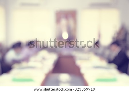 Blur Blurred businessman and woman in meeting room studying documents and discussion for marketing plans - stock photo