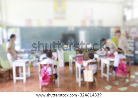 Blur Blurred school teachers action in the classroom with some students on education supervision for improve knowledge quility - stock photo