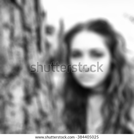 blur blurred unfocused woman girl body portrait bw black and white standing alone outside near the old tree trunk