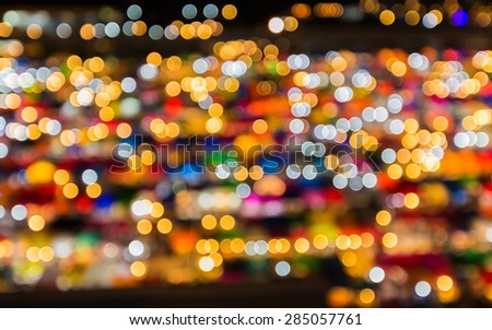 Blur bokeh background of multicolour lights of free market at night  - stock photo