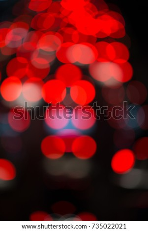 Blur / Bokeh of the car lights in the day that has very busy traffic on the road, in red, golden, white, blue colors