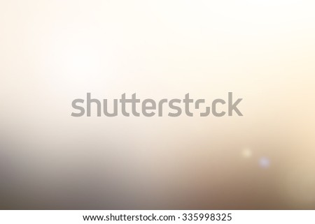blur bright cream colour tone backgrounds with flare lights.abstract blurred sepia backdrop wallpaper concept.blur christmas festive backdrop concept. - stock photo