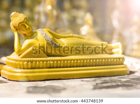 Blur buddha statue in Buddhism with color filters and selective focus - stock photo