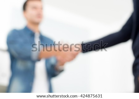 Blur casual businessmen making handshake, can be used as background - stock photo