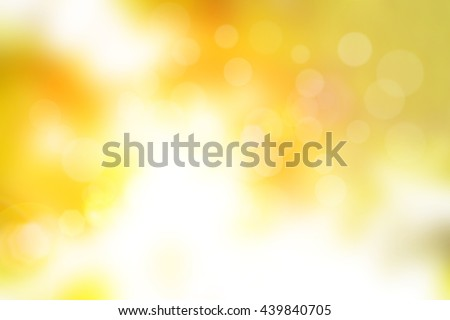 Blur circle bokeh green leaf background. Blurry yellow leaves rays light flare nature backdrop. Abstract blurred scene for web advertising. Soft focus foliage during summer with sunbeam wallpaper. - stock photo