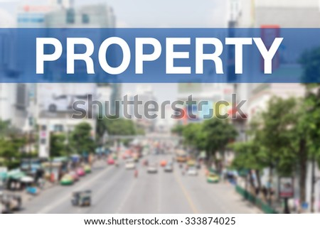 Blur city background with PROPERTY Word - stock photo