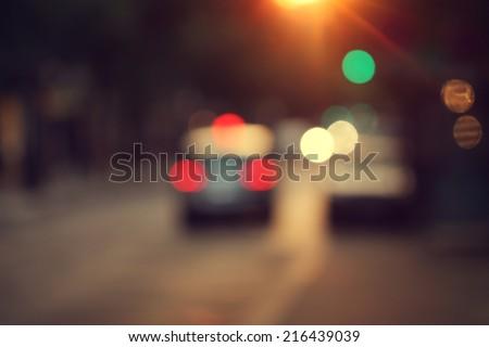 blur city traffic background at evening sunset - stock photo