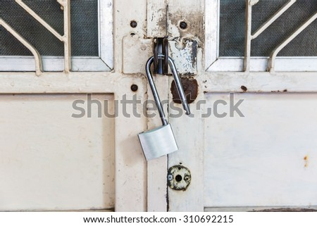 Blur, Closed lock on an old metal fence - stock photo