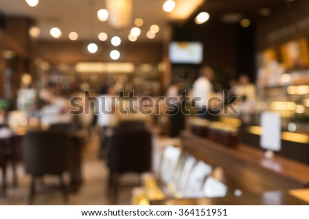 Blur coffee shop  or cafe restaurant with abstract bokeh light image background. For create  montage product display - stock photo