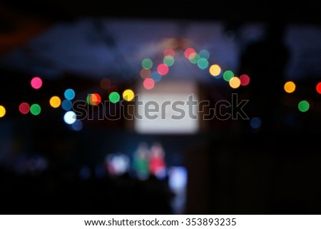 Blur colorful christmas lights bokeh on party background - stock photo