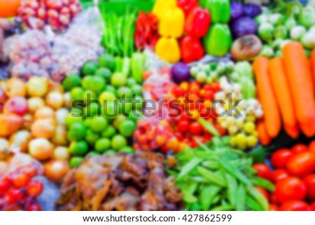 Blur Colorful fruits and vegetables background in the market.