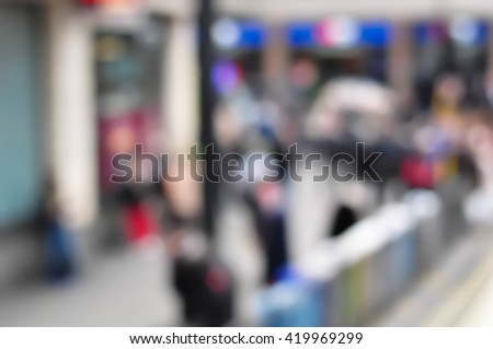 Blur Crowd of People On Street, unrecognizable crowded population as blur urban background, Vintage Toned Image. - stock photo
