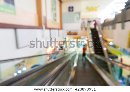 Blur Defocus Background of Two way Escalator in Modern Building such as Airport, Superstore or commercial Building - stock photo