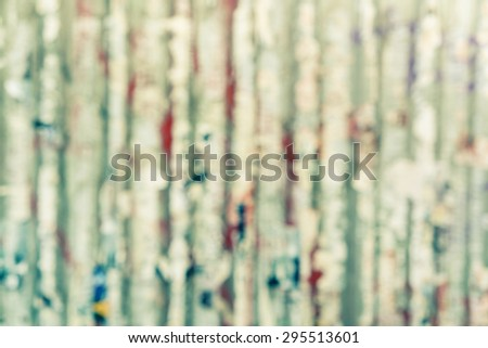 blur dirty grunge wall with torn advertisement poster backgroud  - stock photo