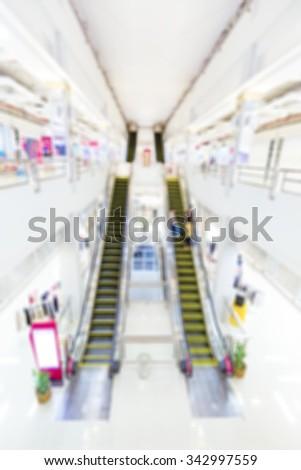 blur escalators in shopping mall - stock photo