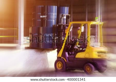 Blur Forklift truck Oil truck - stock photo