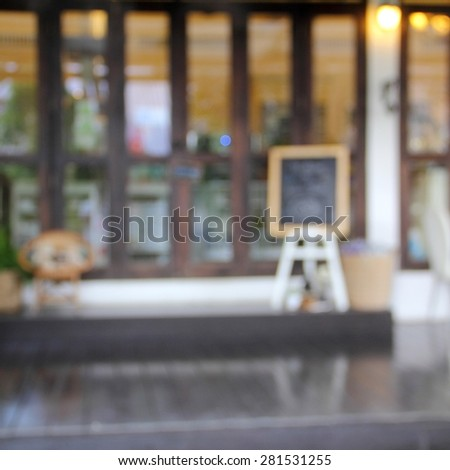 blur front of shop glass wood door and write board square format - stock photo