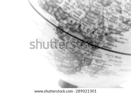 Blur globe close up, Africa past in gray scale - stock photo