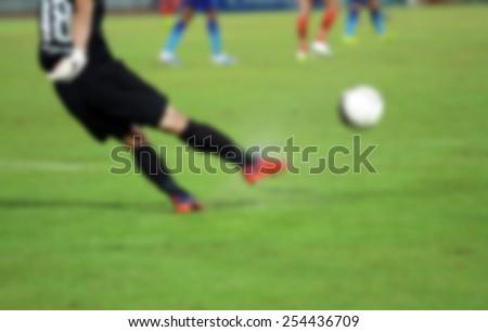blur goalkeeper knocks the ball for background - stock photo