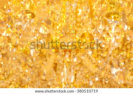 Blur Golden bokeh from chandelier ornaments. Abstract blur yellow background - stock photo
