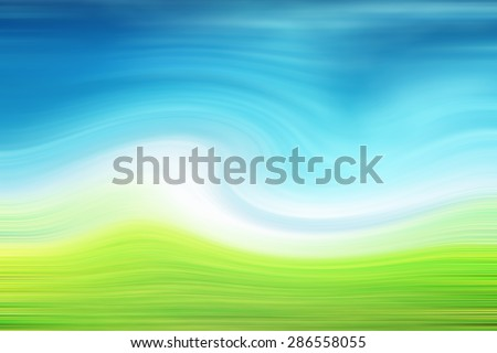 blur green grass and blue sky - stock photo