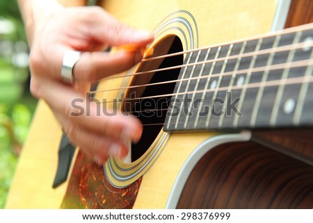 Blur hand with playing the guitar - stock photo
