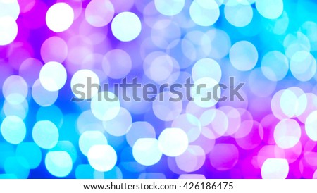 Blur holiday lights can be used for background. Celebration, festive, wedding, birthday, Christmas lights out of focus. Purple and blue color scheme. - stock photo